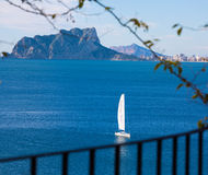 Ifach Penon view of calpe  in Alicante. Ifach Penon view of calpe and Sailboat from Moraira in Mediterranean Alicante at Spain Royalty Free Stock Image