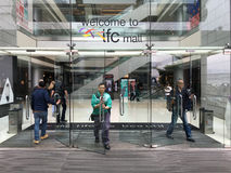 IFC Mall entrance, in Hong Kong. HONG KONG - MAR 18, 2017: People enter IFC Mall. It is a 4 storey shopping mall, with many luxury retail brands and wide variety Stock Photo