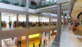 Ifc shopping mall : hong kong. Busy shoppers at the ifc shopping mall in hong kong Stock Photo