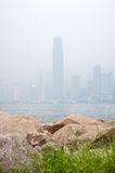 IFC skyscraper in Hong Kong's Central district obscured by air pollution Stock Photo
