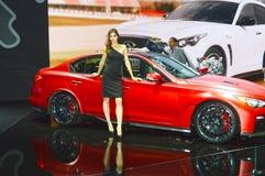 Ifiniti rouge Femmes internationales de salon d'automobile de Moscou Photos libres de droits