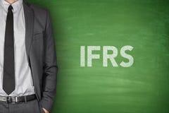 IFRS on blackboard. International financial reporting standards on green blackboard Stock Photos