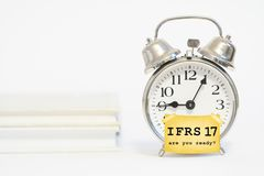 Ifrs 17 insurance accounting standard. Concept with alarm clock Royalty Free Stock Image