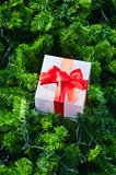 Ift box and red ribbon on christmas tree Royalty Free Stock Photos