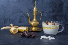 Iftar or Suhoor snack close up of dates with yogurt stock photography