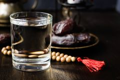 Iftar water for Ramadan fast opening. Iftar water for Ramadan fast opening on black table Royalty Free Stock Photography