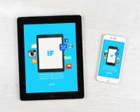 IFTTT app på Apple iPhone 6 och iPadskärm Royaltyfri Foto