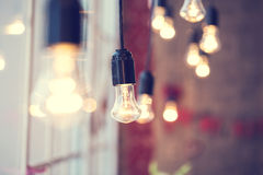 Iful festoon light bulb hanging at the window Stock Image