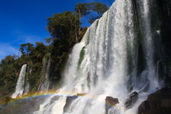 Igausy falls with rainbow. Iguassu Falls is the largest series of waterfalls on the planet, located in Brazil Stock Images