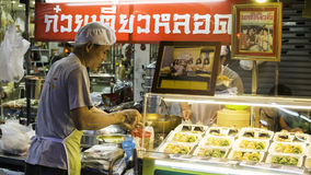 Ight market for Chef cooking  on chinatown (Yaowarat) Road,the main street in Chinatown. Royalty Free Stock Images