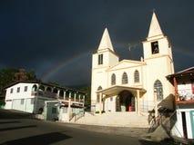 Iglesia baptista con el arco iris Fotos de archivo libres de regalías