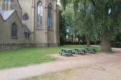 Iglesia católica en parque Imagenes de archivo