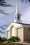 Iglesia con la aguja grande Foto de archivo