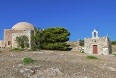 Iglesia de Agia Ekaterini y mezquita en Fortezza Rethymno Imagenes de archivo