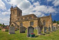 Iglesia de Lorenzo del santo en Cotswolds, Burton-en- Fotografía de archivo