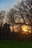 Iglesia de madera en la puesta del sol Imágenes de archivo libres de regalías