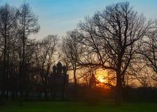 Iglesia de madera en la puesta del sol Foto de archivo libre de regalías