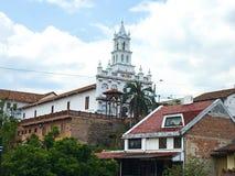 Iglesia de Todos Santos, Cuenca Ecuador. View of Todos Santos Church from the broken bridge overlooking the river. Spanish colonial architecture Royalty Free Stock Photography