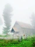 Iglesia del campo en niebla Imágenes de archivo libres de regalías