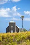 Iglesia en campo de la caña de azúcar Imagen de archivo libre de regalías