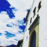 Iglesia en cielo Foto de archivo libre de regalías