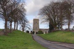Iglesia en el extremo del camino Foto de archivo libre de regalías