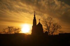 iglesia en el tiempo de la puesta del sol Fotos de archivo