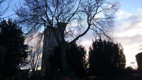 Iglesia en la puesta del sol imagen de archivo libre de regalías