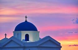 Iglesia griega en la puesta del sol Fotografía de archivo libre de regalías