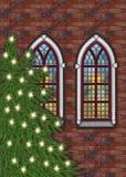 Iglesia vieja del ladrillo con el árbol de navidad Foto de archivo libre de regalías