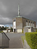 Iglesia y aguja con la cruz Imagen de archivo libre de regalías