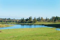 Iglesia y aldea de Carham en tweed del río foto de archivo libre de regalías