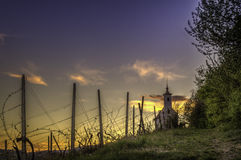 Iglesia y la puesta del sol Foto de archivo libre de regalías