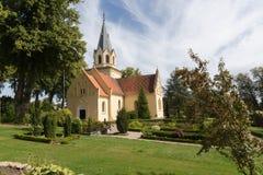 Iglesia y pequeños árboles Fotografía de archivo