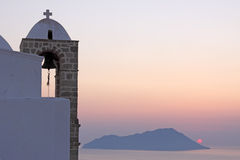 Iglesia y puesta del sol Foto de archivo