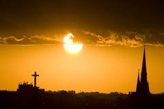 Iglesias en la puesta del sol Foto de archivo libre de regalías