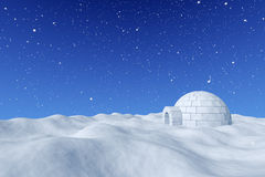 Igloo ice-house under blue sky with snowfall. Winter north polar snowy landscape - eskimo house igloo icehouse made with white snow on surface of snow field Royalty Free Stock Image