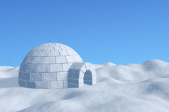 Igloo icehouse under blue sky closeup view. Winter north polar snowy landscape - eskimo house igloo icehouse made with white snow on the surface of snow field Stock Image