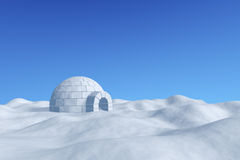 Igloo icehouse under clear blue sky. Winter north polar snowy landscape - eskimo house igloo icehouse made with white snow on the surface of snow field under Stock Photo