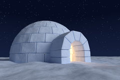Igloo icehouse with warm light inside under night sky with stars Stock Photography