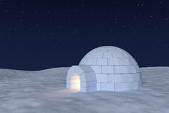 Igloo icehouse with warm light inside under night sky with stars. Winter north polar snowy landscape: eskimo house igloo icehouse with warm light inside made Royalty Free Stock Photos