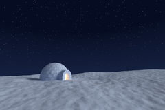 Igloo icehouse with warm light inside under night sky with stars Royalty Free Stock Image