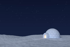 Igloo icehouse with warm light inside under sky with stars Royalty Free Stock Photo