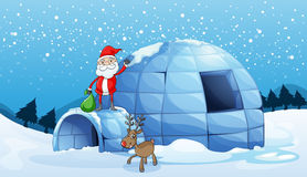 An igloo and a santa clause Royalty Free Stock Photos