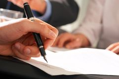 Igning a contract. Close up of a hand signing a contract Stock Images