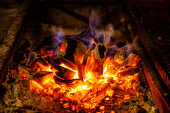 Ignite the coals on the grill for cooking BBQ Royalty Free Stock Photo