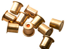 Igniter capsules of 12 gauge cartridges isolated Stock Image