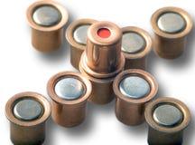 Igniter capsules of 12 gauge cartridges isolated on white background. Macro shot Stock Photos