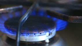 The igniting flame of the gas stove. close-up. Turn on the gas stove. The igniting flame of the gas stove. close-up stock video footage