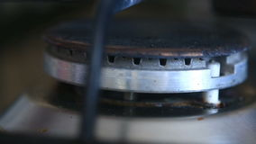 The igniting flame of the gas stove. close-up. Turn on the gas stove. The igniting flame of the gas stove. close-up stock video